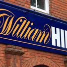 William Hill sunk more than 7%, or 22.1p to 289.4p, amid reports of MPs planning a clampdown on betting machines