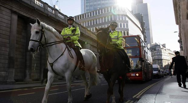 Security has been stepped up around strategic business premises in London.
