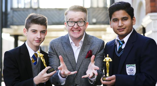 Padraig McCartney (left) from Corpus Christi College and Vishwas Kumar from Malone College joined illusionist and motivational speaker David Meade as part of Lockton's 'Lock On' mentoring programme for young people
