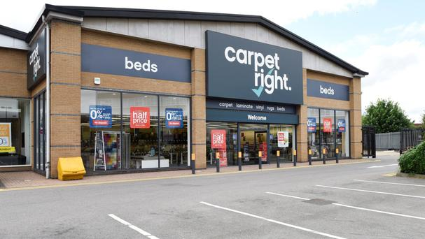 Carpetright chief executive Wilf Walsh said the first half had been 'challenging'