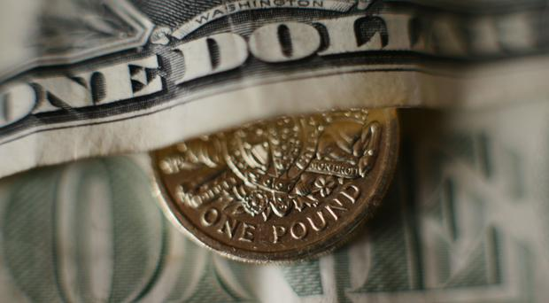 The pound dropped on the back of a surging dollar