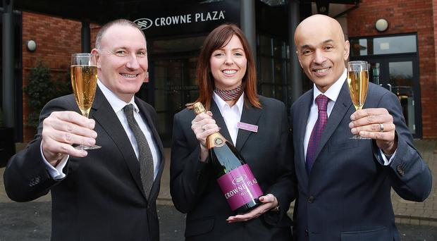 From left, Gerry Lennon, chief executive of Visit Belfast ,with Stacy Feeney of the Crowne Plaza and Rajesh Rana of Andras Hotels
