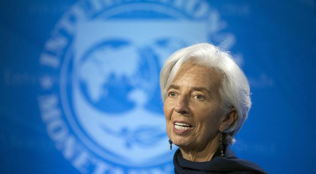 Christine Lagarde makes a statement after the IMF's executive board reaffirmed its full confidence in her, in Washington (AP)