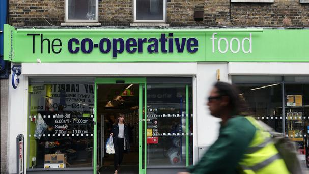 The Co-operative Group has got the go-ahead to sell 300 stores - including five in Northern Ireland