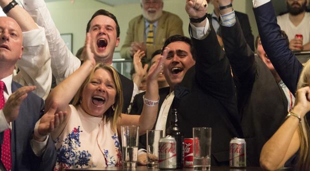 Vote Leave supporters cheer the Brexit vote