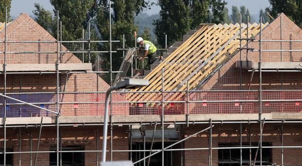 The construction industry will build 200,000 new homes next year, the boss of Redrow has forecast
