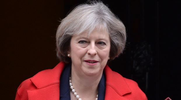 Theresa May is being urged to ensure public servants are 'properly paid'