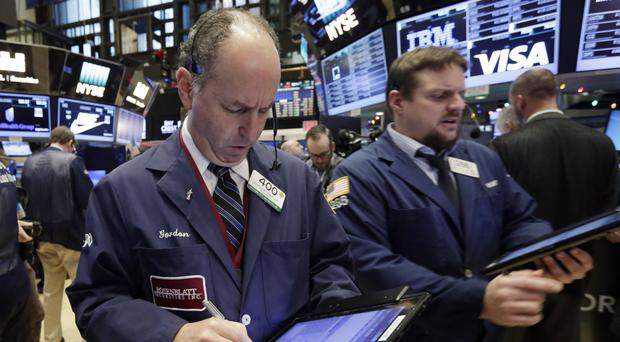 The stock market opened the year on a strong note, led by big gains in banks and energy companies (AP)