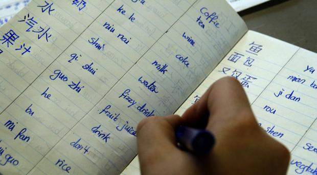 Many parents believe Mandarin Chinese is the most useful language for their children to learn