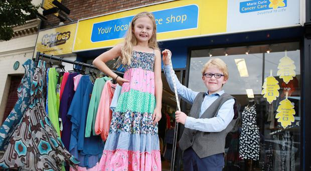Madeline Haldane and Luther McIlveen launch a charity shop challenge at a Marie Curie premises in Belfast in 2014.