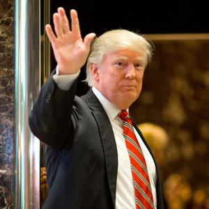 President-elect Donald Trump waves to the media after a meeting in New York