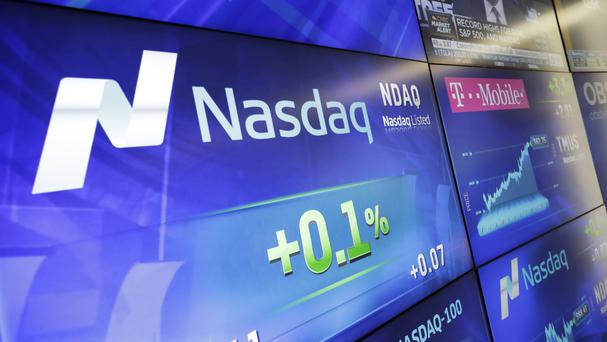 The Standard & Poor's 500 index and Nasdaq composite posted small losses, snapping two days of consecutive record highs