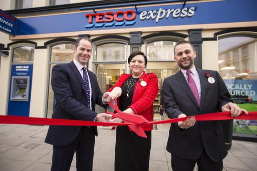 Tesco area manager Stephen Magill, store manager Alexis McIlveen and deputy store manager Aaron McGuigan