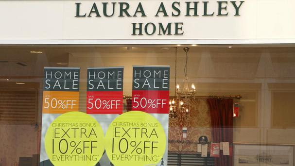 Laura Ashley revealed a 29% plunge in pre-tax profits to £7.8 million for the six months to December 31