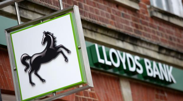 Lloyds said bottom line profits surged last year as it saw lower costs of compensation for the payment protection insurance scandal