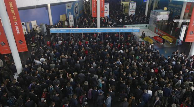 Visitors wait to enter to the Mobile World Congress in Barcelona, Spain (AP)