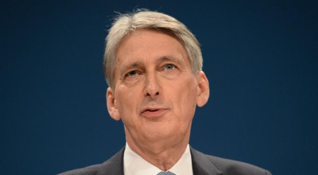 Chancellor Philip Hammond is set for a windfall in next week's Budget
