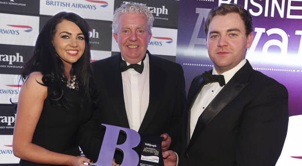 Conleth and Naoimh McConville celebrate with their father Brian at last year's Belfast Telegraph Business Awards after he was named Businessperson of the Year