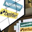 Paddy Power Betfair said cost benefits of its merger last February are ahead of schedule