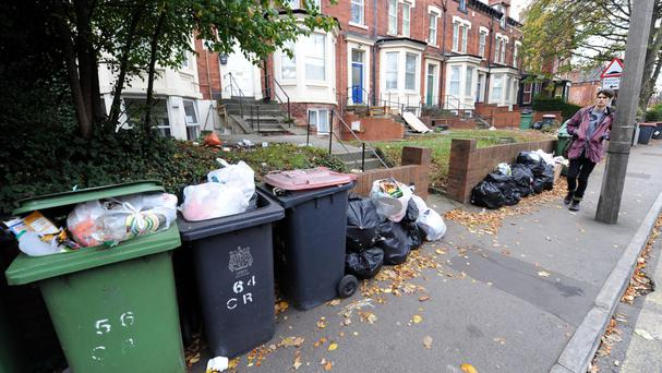 Refuse workers are among those facing large real-terms pay cuts