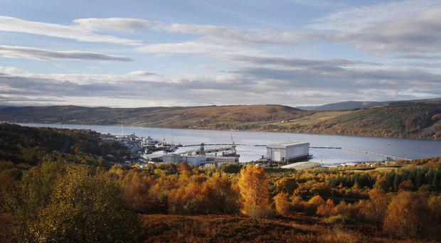 Faslane civilian staff have backed industrial action in a dispute over workers' rights