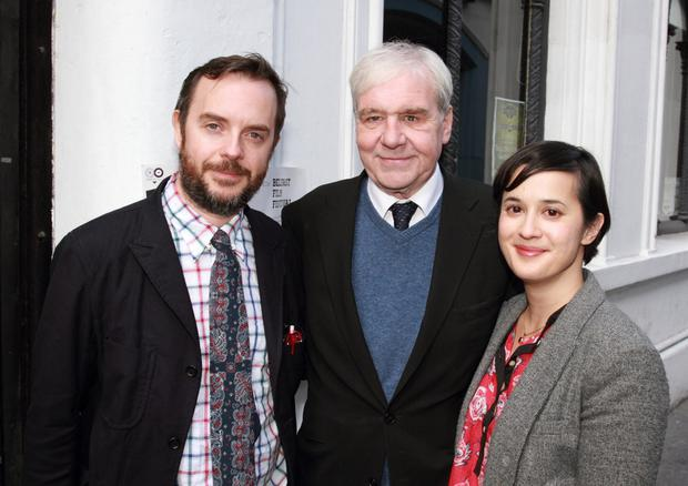 Terri Hooley (centre) with Good Vibrations film directors Glenn Leyburn and Lisa Barros D'Sa at the Black Box, and (inset) comedian Owen O'Neill performing at the venue in Belfast's Cathedral Quarter