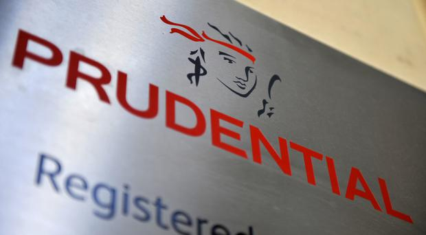 Prudential boss Mike Wells cheered its seventh year running of double-digit profit growth in its fast-growing Asian business, which helped offset the domestic disappointment