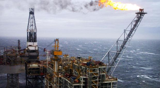A report predicts the Scottish economy will continue to lag behind the UK, largely due to the downturn in the North Sea oil and gas industry