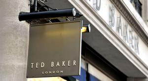 Ted Baker said it has been hit by increased levels of promotional activity and a fall in international tourism in the US and Canada