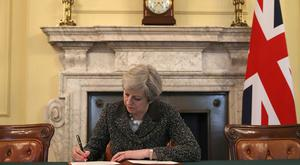 Prime Minister Theresa May signing the Article 50 letter
