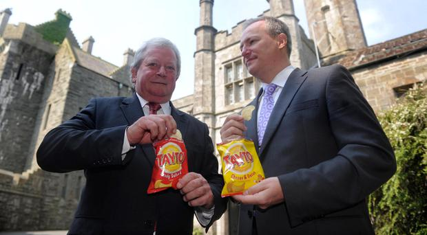 Tayto chairman Raymond Hutchinson and chief executive Paul Allen at the company's Tandragee headquarters
