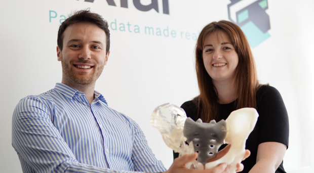 Daniel Crawford, chief executive of axial3D, and operations manager Cathy Coomber with a 3D-printed model of a pelvis