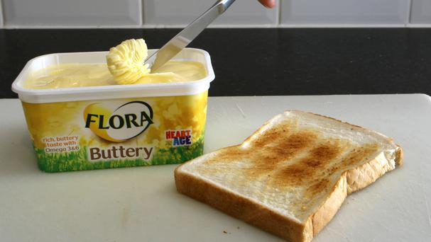 Unilever to sell Flora as household giant regroups after Kraft takeover bid
