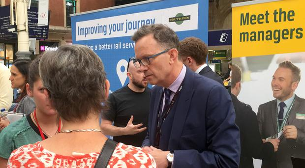 Pay was almost doubled for Charles Horton (centre), of Govia Thameslink Railway (GTR), which runs Southern Rail