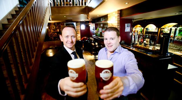 Gavin Weir (left), director of GVA NI and Gavin Bates, owner of the White Horse, toast their partnership as the deal is made final on the 200-year old bar and restaurant in Saintfield