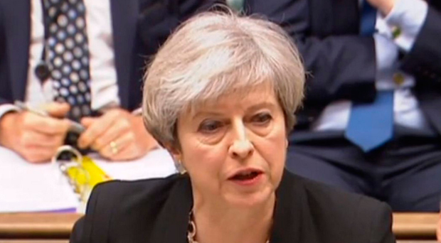 Prime Minister Theresa May speaks during Prime Minister's Questions yesterday in the House of Commons