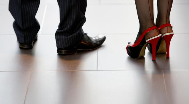 Ministers rejected calls to make it illegal for companies to require women to wear high heels at work