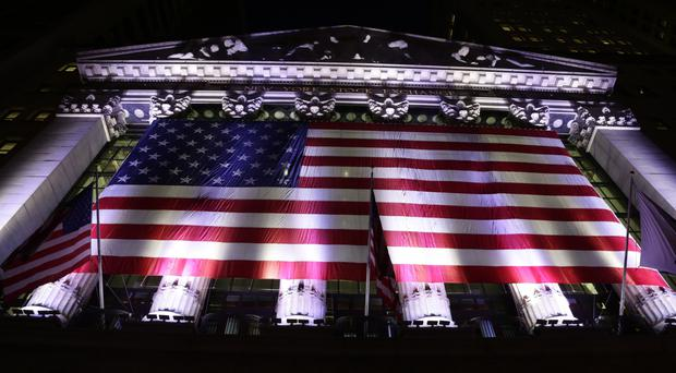 American flag hangs on the front of the New York Stock Exchange (AP Photo/Peter Morgan)
