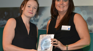 Jamesina Doble receives her CISI Operations Award from Kerrie Fleetwood of IFDS