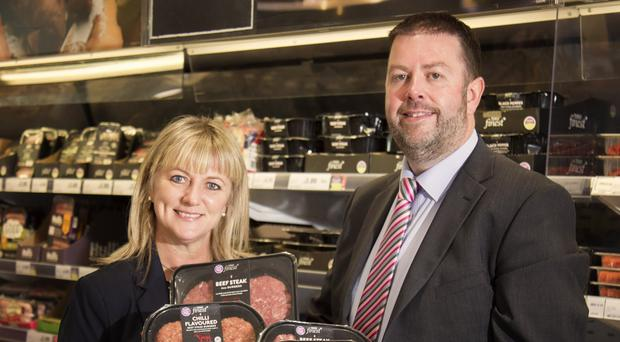 Caoimhe Mannion of Tesco NI and Alan McKeown, commercial sales manager at Doherty & Gray