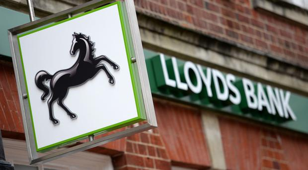 British government cuts stake in Lloyds bank to below 1 percent