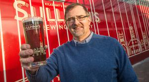 Head brewer Ian Hamilton with a pint of Sullivan's