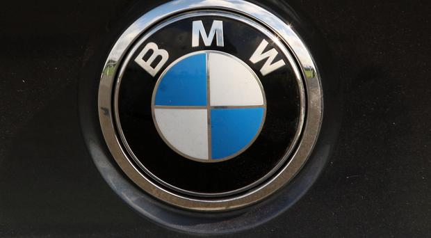 BMW workers are to stage a protest outside one of the car maker's prestige showrooms as part of a dispute over pensions.