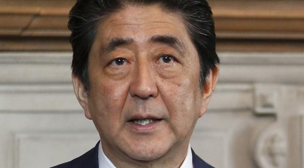 Japan's prime minister Shinzo Abe at a press conference with Theresa May