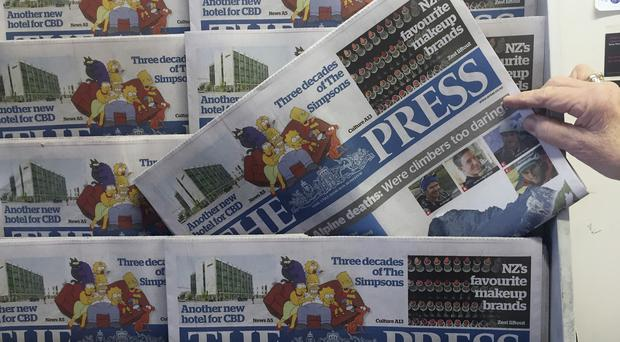 Editions of The Press newspaper, owned by Fairfax Media, on the news-stands in Christchurch, New Zealand (AP)