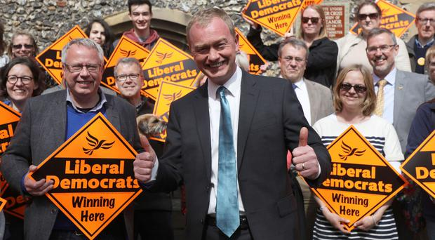 Tim Farron, pictured at a campaign event in St Albans, has denied he was a Tory boy