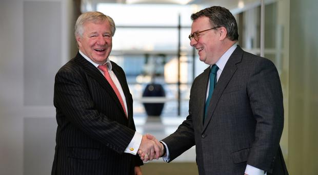 Keith Skeoch, Standard Life chief executive, and his opposite number at Aberdeen Asset Management Martin Gilbert shake hands on the £11 billion deal (Standard Life/PA)