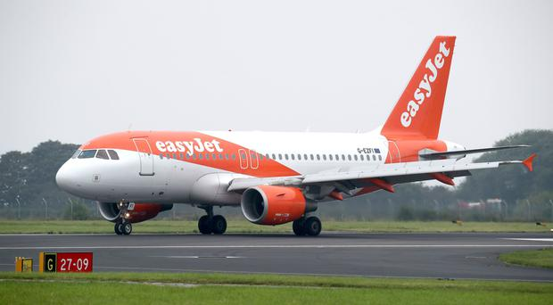Low-cost carrier Easyjet reported a £236 million pre-tax loss in the six months to March 31