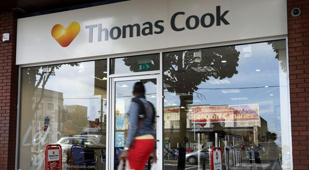 Thomas Cook said holiday sales to Greece surged 36% in the half-year to March 31, which helped lift interim revenues by nearly 3%