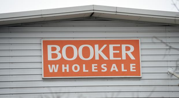 Booker chief executive Charles Wilson said record annual performance showed the group was not fazed by a £3.7 billion deal with Tesco